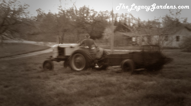 image of tractor and spreader, spreading manure for hay crop  Partial organic practices, not certified